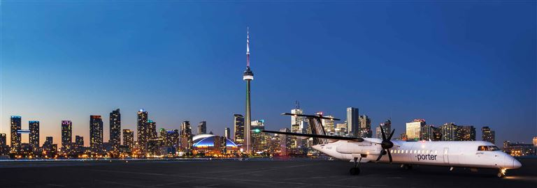 Porter aircraft with downtown Toronto skyline