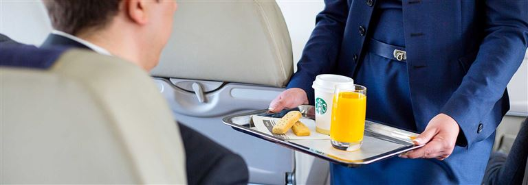 Passengers enjoy complimentary services, including free in-flight wine, beer and